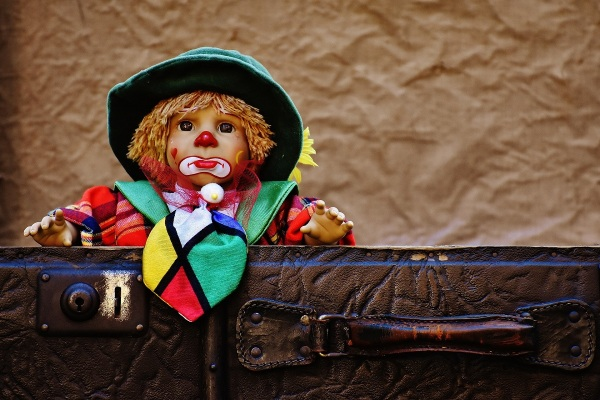 Clown in suitcase - how can I leave you again?